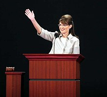 photograph of woman at lectern