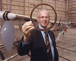 AeroVironment - AeroVironment founder and former Chairman Paul MacCready shows a cross section of the AeroVironment/NASA Helios Prototype wing spar.