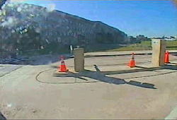 The first of the five video frames leaked in 2002 showing the Pentagon just before impact.