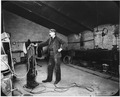 Photograph of a San Francisco Mint employee in an attic workshop. - NARA - 296565.tif