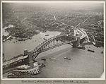 Pilot boat Captain Cook passing under Sydney Harbour Bridge, 19 March 1932 (6174057402).jpg