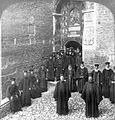 Pious monks of the Eastern Orthodox Church at door of Megaspelaeon monastery, Greece.jpg