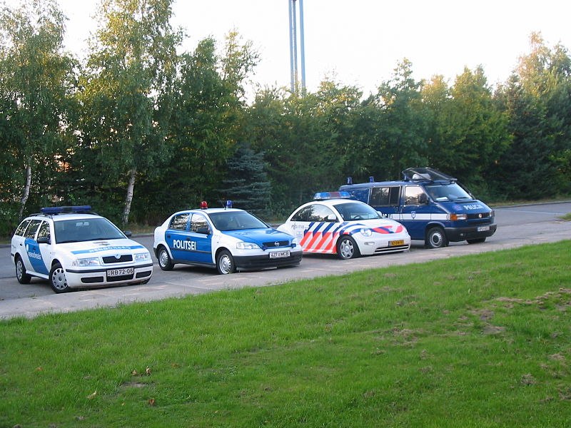 File:Police cars several countries.JPG