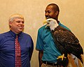 Posing for picture with Bald Eagle. (10594716994).jpg