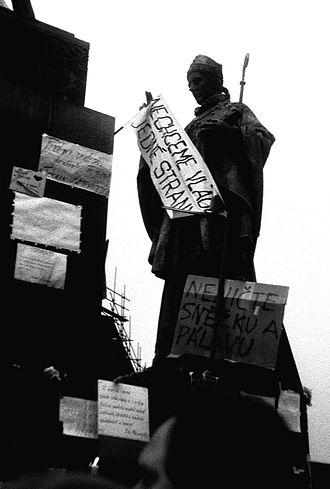 Stuha - A statue of Saint Adalbert of Prague with a streamer and banners
