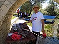 Preparation of smoked carp at the Carp Day Festival in Plavnica, Montenegro 08.jpg
