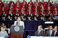 President Reagan addresses the Ecumenical Prayer Breakfast at Reunion Arena in Dallas Texas with George Bush and Ken Cooper looking on.jpg