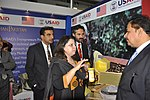 Provincial Minister for Agriculture Dr. Farrukh Javed interacting with USAID's representative, Mr. Ghani Khan Marwat at Dawn Sarsabz Pakistan Agri Expo (13163694605).jpg