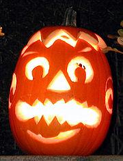 A pumpkin carved into a Jack-o'-lantern for Halloween.