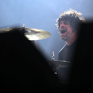Joey Castillo - Castillo performing with Queens of the Stone Age in 2011.
