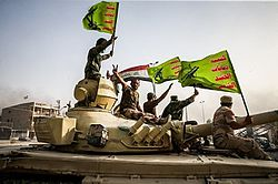 Raising flag of Iraq and Popular Mobilization Forces after defeating DAESH.jpg