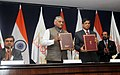Raj Kumar Singh and the Minister of State for External Affairs, General (Retd.) V.K. Singh at the signing ceremony the Host Country Agreement between MEA and ISA, in New Delhi (1).jpg