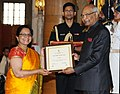 Ram Nath Kovind presenting the Nari Shakti Puruskar for the year 2017 to Vanastree, Sirsi, Karnataka (Institutional), at a function, on the occasion of the International Women's Day, at Rashtrapati Bhavan, in New Delhi.jpg