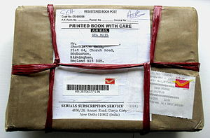 Registered mail - A registered parcel sent from India to the UK with electronic barcode registration.