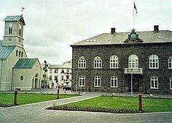 The House of Parliament in Reykjavík next to the cathedral to the left
