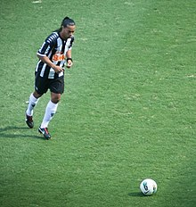 Footballer preparing to kick a ball