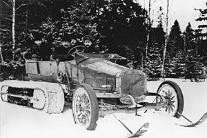 "Kégresse track - ""Russo-Balt"" ""C24-30"" from the garage of Tsar Nicholas II with Kegresse track design of Adolphe Kegresse. Adolphe Kégresse possibly seated on the right of the photograph"