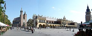 Polish architecture: Main Market Square in Kraków. St Mary's Basilica (left), Sukiennice (centre), Town Hall Tower (right)