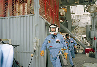 Flight suit - Astronauts Richard O. Covey (front) and Joe H. Engle rush from the Discovery during emergency launch-mode egress training at Kennedy Space Center (KSC).