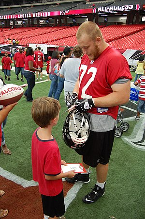 "Sam Baker (offensive tackle) - Baker signs an autograph in the 2008 ""Roam the Dome"" event at the Georgia Dome."