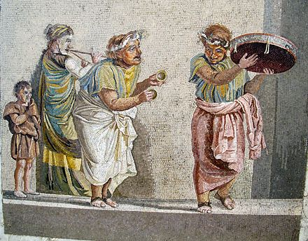 Trio of musicians playing an aulos, cymbala, and tympanum (mosaic from Pompeii)