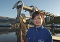 Scottish shooter Jennifer McIntosh holds the baton at the Falkirk Wheel, which links the canal to the marina.jpg