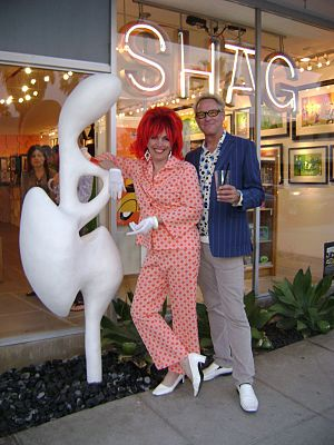 Cherry Capri - Sculpture by Cherry Capri in front of SHAG store in Palm Springs, CA, posing with artist Josh Agle