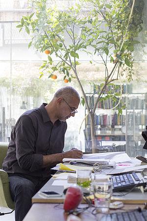 Senan Abdelqader - Senan Abdelqader in his office in Jerusalem (2015)