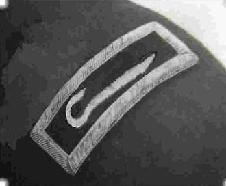 """Religious symbolism in the United States military - The """"Shepherd's Crook,"""" the original insignia authorized for U.S. Army chaplains, 1880–1888, and still included as part of the U.S. Army Chaplain Corps regimental insignia"""
