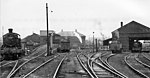 Shrewsbury (Coleham) Locomotive Depot View SE of two adjoining Depots of the ex-Great Western (left) and ex-London & North Western (right), which were situated beside the junction of the Severn Valley line (to Bridgnorth, Bewdley etc., closed 2/12/63) with the Shrewsbury - Hereford main line (GW & LNW Joint). They provided motive power for all the local and many of the main-line passenger and freight traffic in the area - except for the moribund Shropshire & Montgomeryshire Railway, which passed just to the east of the Depots as it entered Shrewsbury Abbey Station. In 1950, shortly after this photograph, the combined Depots (coded 84G in the Wolverhampton District of the BR Western Region) had an allocation of 124 locomotives, comprising:- 38 4-6-0s (19 GW, 19 LMS), 4 2-6-0s (all GW), 23 2-8-0s (2 GW, 16 LMS, 5 ex-WD), 5 0-8-0s (all LMS), 25 0-6-0s (7 GW, 18 LMS), 7 2-6-2Ts (3 GW, 4 LMS), 6 0-6-2Ts (5 GW, 1 LMS), 14 0-6-0Ts (12 GW, 2 LMS) and 2 0-4-0Ts (both LMS). There were a remarkable number of ancient engines in the LMS section - one of which (probably ex-LNW 0-6-2T No. 58904) can be seen on the right. The Depot closed to steam on 6/11/67, but was utilised for Diesel locomotive until 1972.