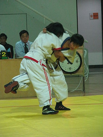 "Shuai jiao - A modern Shuai jiao match. A fighter is trying to take down or ""sweep"" his rival with a leg hook."