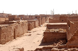 M'Hamid El Ghizlane - Decaying adobe buildings in a side street of M'Hamid