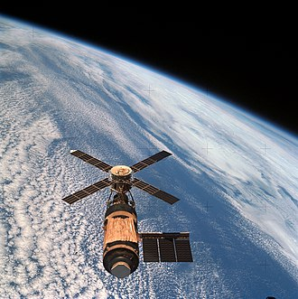Skylab 4 - The final view of Skylab, from the departing mission 4 crew, with Earth in the background