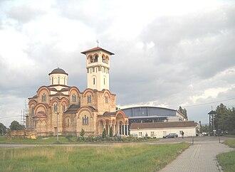 Slana Bara - View of Slana Bara - older wooden Orthodox church, new Orthodox church and Sports center