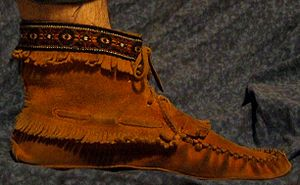 Fringe (trim) - Moccasin with fringe.