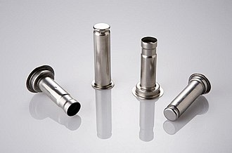 Solenoid valve - Example core tubes. Non-magnetic core tubes are used to isolate the fluid from the coil. The core tube encloses the plugnut, the core spring, and the core. The coil slips over the core tube; a retaining clip engages the depression near the closed end of the core tube and holds the coil on the core tube.