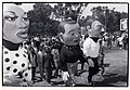 Soweto, South Africa. 1980's. Children following puppeteers with Puppets Against AIDS.jpg