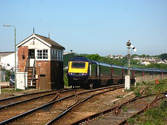 St Erth railway station - A train going to London passes the signal box as it leaves St Erth