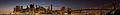 Statue of Liberty, Manhattan, Brooklyn Bridge, Empire State Building, Chrysler Building, and Manhattan Bridge, 180 degree panorama, Blue hour (Explored) (20543682528).jpg