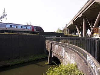 Stour Valley Line - The Stour Valley Line running parallel to the BCN New Main Line canal, crossing the BCN Old Main Line canal and then under the M5 motorway near Smethwick