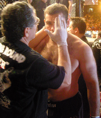 Jacob Duran - Duran prepares Gabriel Gonzaga for a match by applying petroleum jelly to his face.