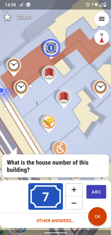 A map with different colored icons on it, currently a quest about a house number
