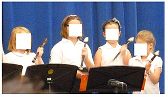 Recorder (educational uses) - An elementary recorder class striking the bell of the recorder during a concert.