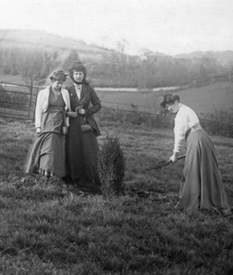 Clara Codd - Codd planting tree with Annie Kenney and Florence Canning on 25 April 1909 at Eagle House