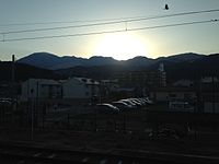 Sunset from platform of Kamegawa Station.JPG