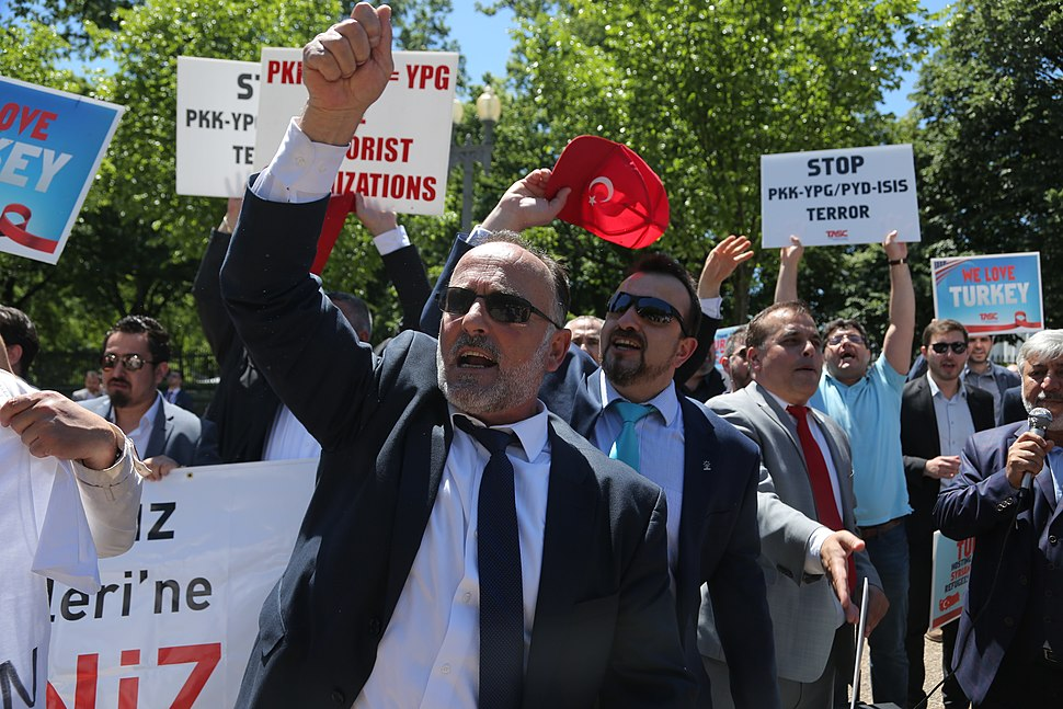 Supporters of Turkish President Recep Tayyip Erdogan react to anti-Erdogan supporters outside the White House in Washington 01
