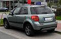 Suzuki SX4 1.6 4x2 limited (Facelift) – Heckansicht, 17. September 2011, Düsseldorf.jpg