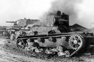 12th Mechanized Corps (Soviet Union) - A T-26 lies smoking with a KV-1 behind in Russia in 1941