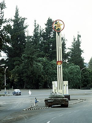 Cold War (1985–1991) - Ethiopian tanks pass a Communist memorial in Addis Ababa during the Ethiopian Civil War, 1991
