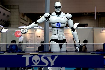 A Vietnamese-made TOPIO 3.0 humanoid ping-pong playing robot displayed during the 2009 International Robot Exhibition (IREX) in Tokyo. TOPIO 3.jpg